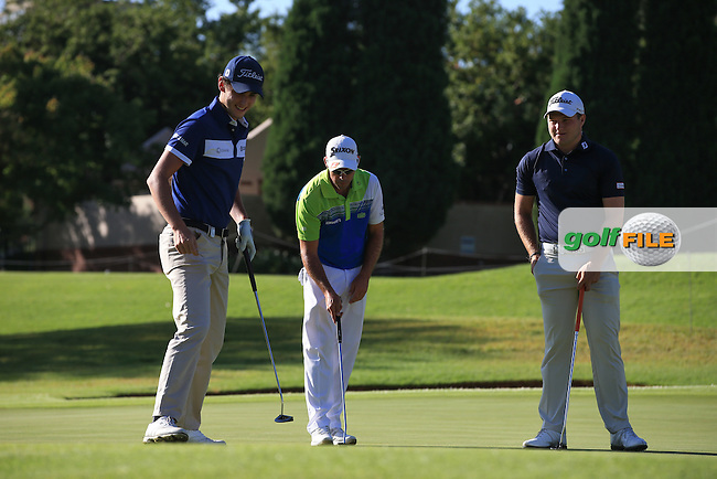 Getting ready to begin again, Renato Paratore (ITA), Jaco Van Zyl (RSA) and Zander Lombard (RSA) mark their balls on the 9th green, before the recommencement of Round Three of the 2016 BMW SA Open hosted by City of Ekurhuleni, played at the Glendower Golf Club, Gauteng, Johannesburg, South Africa.  10/01/2016. Picture: Golffile | David Lloyd<br /> <br /> All photos usage must carry mandatory copyright credit (&copy; Golffile | David Lloyd)