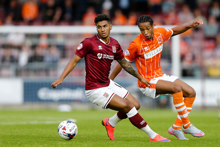 Blackpool's Kwame Thomas vies for possession with Northampton Town's Josh Lelan<br /> <br /> Photographer Craig Mercer/CameraSport<br /> <br /> Football - Capital One Cup First Round - Northampton v Blackpool - Tuesday 11th August 2015 - Sixfields Stadium - Northampton<br />  <br /> &copy; CameraSport - 43 Linden Ave. Countesthorpe. Leicester. England. LE8 5PG - Tel: +44 (0) 116 277 4147 - admin@camerasport.com - www.camerasport.com
