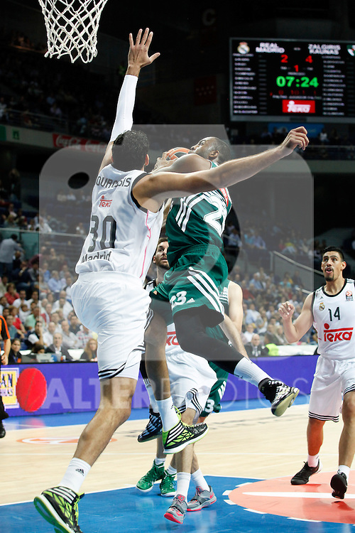 Basketball Real Madrid´s Bourousis (L) and Zalgiris Kaunas´s Anderson during Euroleague basketball match in Madrid, Spain. October 17, 2014. (ALTERPHOTOS/Victor Blanco)