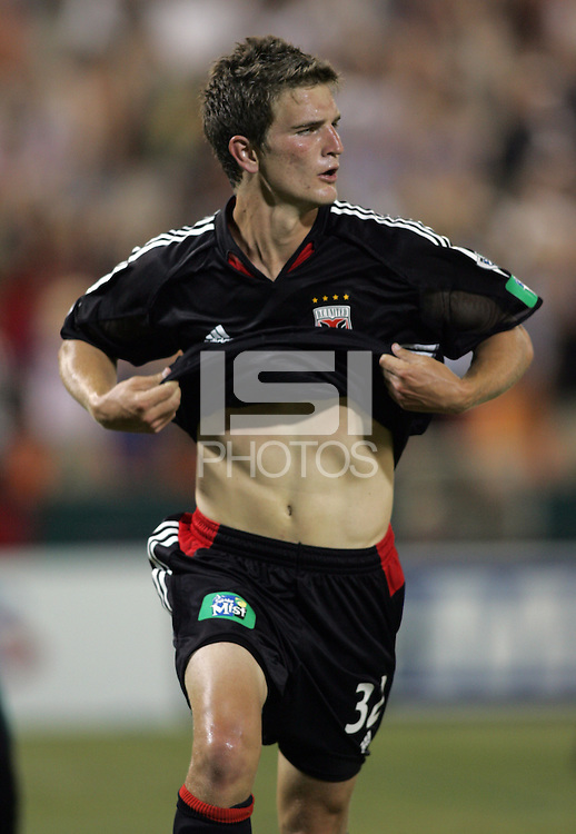 June 15, 2005; Washington, DC, USA; DC United's Bobby Boswell (32) celebrates his game-winning goal against the Chicago Fire at RFK Stadium. DC United  won the game, 4-3.