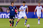 Eldor Shomurodov of Uzbekistan (R) is followed by Ito Junya of Japan (L) during the AFC Asian Cup UAE 2019 Group F match between Japan (JPN) and Uzbekistan (UZB) at Khalifa Bin Zayed Stadium on 17 January 2019 in Al Ain, United Arab Emirates. Photo by Marcio Rodrigo Machado / Power Sport Images