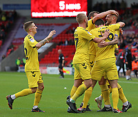 Fleetwood Town's Ashley Eastham is mobbed after scoring his side's third goal <br /> <br /> Photographer David Shipman/CameraSport<br /> <br /> The EFL Sky Bet League One - Doncaster Rovers v Fleetwood Town - Saturday 6th October 2018 - Keepmoat Stadium - Doncaster<br /> <br /> World Copyright &copy; 2018 CameraSport. All rights reserved. 43 Linden Ave. Countesthorpe. Leicester. England. LE8 5PG - Tel: +44 (0) 116 277 4147 - admin@camerasport.com - www.camerasport.com