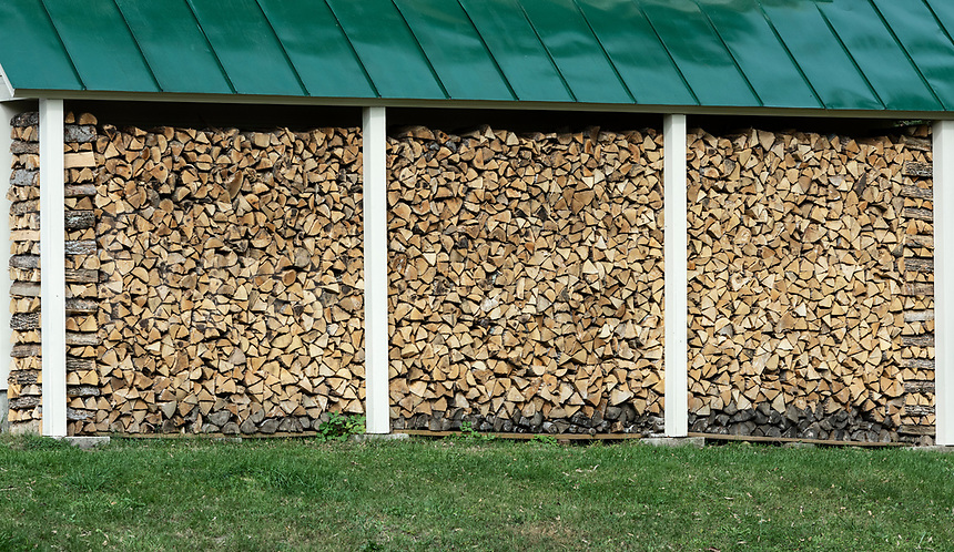 A seson supply of firwood neatly stacked and dry, Vermont, USA.