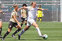 Christie Welsh #13 of the Los Angeles Sol attacks the defense of FC Gold Pride during their match at Home Depot Center on April 19, 2009 in Carson, California.