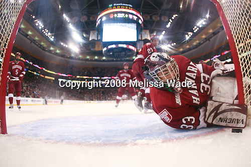 Kyle Richter (Harvard 33) sees the puck on the wrong side of the line for Gibbon's first goal. The Boston College Eagles defeated the Harvard University Crimson 6-5 in overtime on Monday, February 11, 2008, to win the 2008 Beanpot at the TD Banknorth Garden in Boston, Massachusetts.
