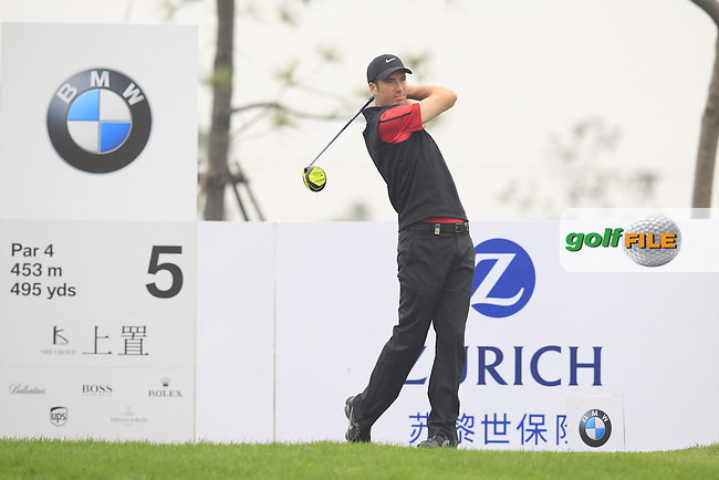 Ross Fisher (ENG) tees off the 5th tee during Saturay's Round 3 of the 2014 BMW Masters held at Lake Malaren, Shanghai, China. 1st November 2014.<br /> Picture: Eoin Clarke www.golffile.ie