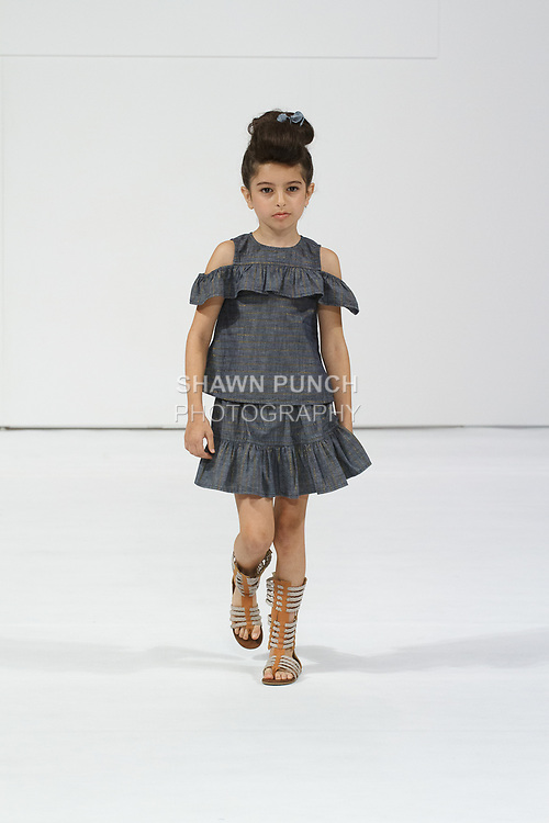 Child model walks runway in an outfit from the Blue & Blue collection by Aaina Jain, during petitePARADE Spring Summer 2018 with Children's Club, at the Javits Center on August 6, 2017.