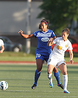 Boston Breakers midfielder Mariah Noguiera (20) and Western New York Flash midfielder Carli Lloyd (10) battle for the ball at midfield.  In a National Women's Soccer League Elite (NWSL) match, the Boston Breakers (blue) tied Western New York Flash (white), 2-2, at Dilboy Stadium on June 5, 2013.