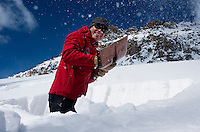 Colorado Avalanche Information Center (CAIC) Avalanche Forecaster Tim Brown (cq) digs out a square of snow to test snow pack at Coon Hill, which stands about 11,150 feet in elevation, and evaluate what type of avalanches may occur in similar regions around Summit County in Colorado, Thursday, February 16, 2012. Tests at this area showed that there was a fairly hard slab of snow resting on weaker snow beneath making conditions which can lead to avalanches...Photo by Matt Nager