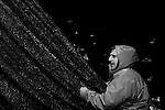 """Joe Allioti works to haul in a catch of anchovies off the coast of Monterey, CA on Monday, January 29, 2007. Joe and his brother Domenic operate their fishing boat """"Allioti Brothers,"""" and are the third generation of their Italian-American family to fish the Monterey Bay."""