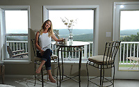 NWA Democrat-Gazette/ANDY SHUPE<br /> Loray Mosher poses Friday, Sept. 9, 2016, in the guest room of her home in Elkins, a favorite place for its views of the valley below.