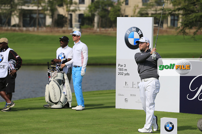 Branden Grace (RSA) tees off the 6th tee during Sunday's Final Round of the 2014 BMW Masters held at Lake Malaren, Shanghai, China. 2nd November 2014.<br /> Picture: Eoin Clarke www.golffile.ie