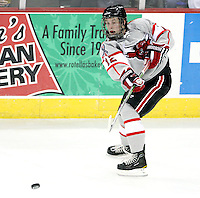 UNO's Brock Montpetit fires a pass. Denver beat Nebraska-Omaha 4-2 Saturday night at Qwest Center Omaha. (Photo by Michelle Bishop)
