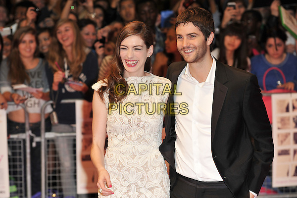 "ANNE HATHAWAY (in Alexander McQueen) & JIM STURGESS.""One Day"" UK premiere, Vue Westfield cinema, Westfield Shopping Centre, London, England..August 23rd, 2011.half length white sleeveless crochet lace dress mouth open laughing  stubble facial hair embroidered shirt black suit .CAP/MAR.© Martin Harris/Capital Pictures."