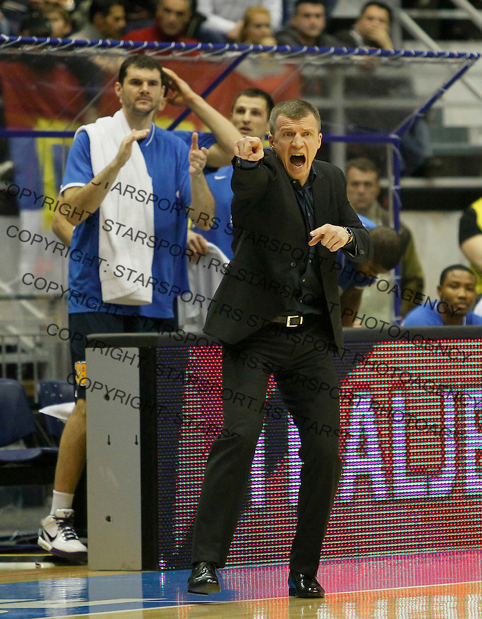 Poland's BC Asseco Prokom head coach Tomas Pacesas, center, during a Euroleague basketball match in Belgrade, Serbia, Wednesday, Dec. 15, 2010. (Srdjan Stevanovic/Starsportphoto.com)