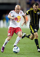 Josh Gardner (31) of the Columbus Crew tries to catch up to Luke Rodgers (9) of the New York Red Bulls during the game at Red Bull Arena in Harrison, NJ.  The New York Red Bulls tied the Columbus Crew, 1-1.