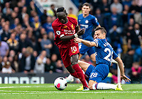 Sadio Mane of Liverpool and Cesar Azpilicueta of Chelsea during the Premier League match between Chelsea and Liverpool at Stamford Bridge, London, England on 22 September 2019. Photo by Liam McAvoy / PRiME Media Images.