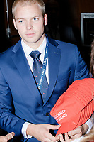 A man hands out Make America Great Again hats outside the ballroom in the Midtown Hilton at the election night victory rally for Republican presidential nominee Donald Trump, on Tues., Nov. 8, 2016. Trump was named president-elect in the early hours of Nov. 9, 2016.
