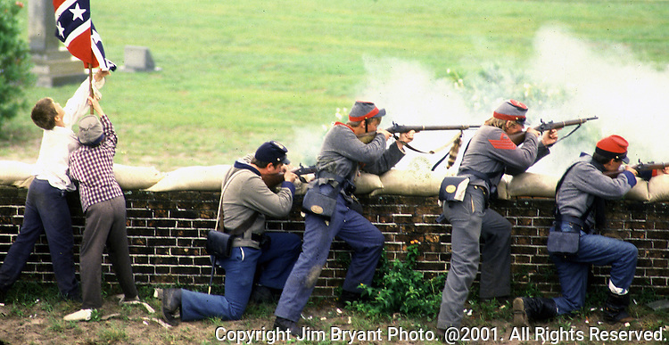 Confederate defenders fire upon attacking Union forces during the Battle of Fort Morgan, Mobile, Al in 2001.  Ft. Morgan, a critical fortification during the Civil War, was the next-to last fortress to fall as the Civil War ended. Jim Bryant Photo. @2001. All Rights Reserved.