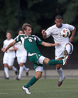Boston College forward/midfielder Amit Aburmad (7) attempts to control the ball as George Mason University defender Eric Zuehsow (8) defends. Boston College defeated George Mason University, 3-2, at Newton Soccer Field, August 26, 2011.
