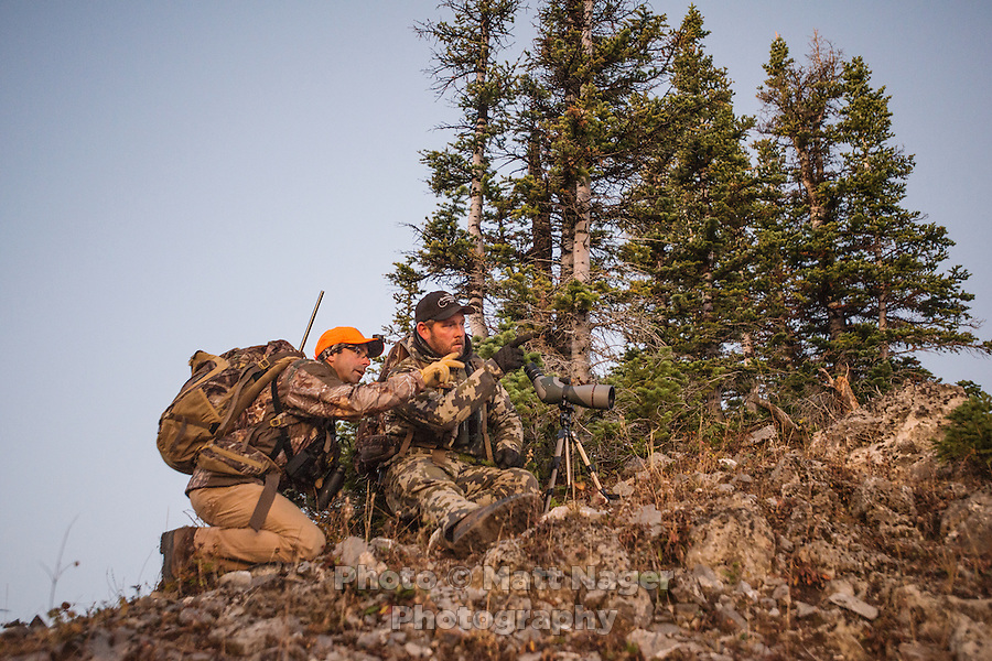 Outdoor Life Editor Andrew McKean and guide Greg Kriese with Trefren Outfitters talk over a mule deer hunt on Greyback Ridge in the Hoeback Drainage of Wyoming Region H, outside of Alpine, Wyoming, September 21, 2015.<br /> <br /> Photo by Matt Nager