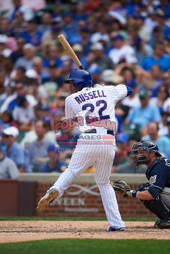 Chicago Cubs shortstop Addison Russell (22) at bat during a game against the Milwaukee Brewers on August 13, 2015 at Wrigley Field in Chicago, Illinois.  Chicago defeated Milwaukee 9-2.  (Mike Janes/Four Seam Images)
