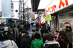 Foreign visitors line up to enter board their tour bus with their shopping in Akihabara district on January 20, 2016, Tokyo, Japan. The Japan National Tourism Organization reported on Tuesday 19th a record increase in foreign visitors in 2015. Approximately 19.73 million people visited Japan from abroad, up 47.3 percent. According to the report there were more Chinese visitors than from any other nation with 4.99 million coming in 2015. South Korea (4 million) and Taiwan (3.67 million) were next on the list, and over 1 million Americans also visited Japan in 2015. The number of visitors is the highest in 45 years and already close to Japan's goal of attracting 20 million foreign visitors in a year by 2020. (Photo by Rodrigo Reyes Marin/AFLO)
