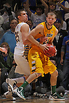 SIOUX FALLS, SD - MARCH 12:  Taylor Braun #24 of North Dakota State runs into pressure from Chad White #25 of South Dakota State during their championship game at the 2013 Summit League Tournament at the Sioux Falls Arena. (Photo by Dick Carlson/Inertia)