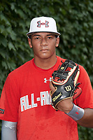 Ricardo de la Torre (1) of the Puerto Rico Baseball Academy in Juana Diaz, Puerto Rico poses for a photo before the Under Armour All-American Game presented by Baseball Factory on July 23, 2016 at Wrigley Field in Chicago, Illinois.  (Mike Janes/Four Seam Images)