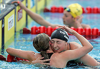 Ariana Kukors of the United States, right, is congratulated by Britain's Hannah Miley after winning the gold medal and setting a world record clocking 2.06.15 in a women's 200 meters medley event at the Swimming World Championships in Rome, 27 July 2009..UPDATE IMAGES PRESS/Riccardo De Luca
