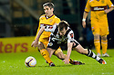 ST MIRREN'S PAUL MCGOWAN IS CHALLENGED BY MOTHERWELL'S KEITH LASLEY .17/12/2011 sct_jsp013_motherwell_v_st_mirren     .Copyright  Pic : James Stewart.James Stewart Photography 19 Carronlea Drive, Falkirk. FK2 8DN      Vat Reg No. 607 6932 25.Telephone      : +44 (0)1324 570291 .Mobile              : +44 (0)7721 416997.E-mail  :  jim@jspa.co.uk.If you require further information then contact Jim Stewart on any of the numbers above.........