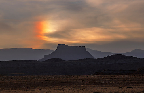 A corona appears during sunset at Factory Butte near Caineville, Utah