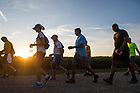 August 18, 2017; At dawn the pilgrims begin the 41.4 mile leg of ND Trail on day 5 from Crawfordville to Lafayette, Indiana. As part of the University's 175th anniversary celebration, the Notre Dame Trail will commemorate Father Sorin and the Holy Cross Brothers' journey. A small group of pilgrims will make the entire 300+ mile journey from Vincennes to Notre Dame over  two weeks.(Photo by Barbara Johnston/University of Notre Dame)