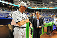 """7 March 2012:  FIU Head Coach Henry """"Turtle"""" Thomas speaks with Miami Marlins President David Samson prior to the start of the exhibition game as the Miami Marlins defeated the FIU Golden Panthers, 5-1, at Marlins Park in Miami, Florida."""