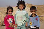 DOMIZ, IRAQ: Three Syrian refugee children pose for a photograph in the Domiz refugee camp in the Kurdish region of northern Iraq...The semi-autonomous region of Iraqi Kurdistan has accepted around 60,000 refugees from war-torn Syria. Around 20,000 refugees live in the Domiz camp which sits 60 km from the Iraq-Syria border...Photo by Younes Mohammad/Metrography
