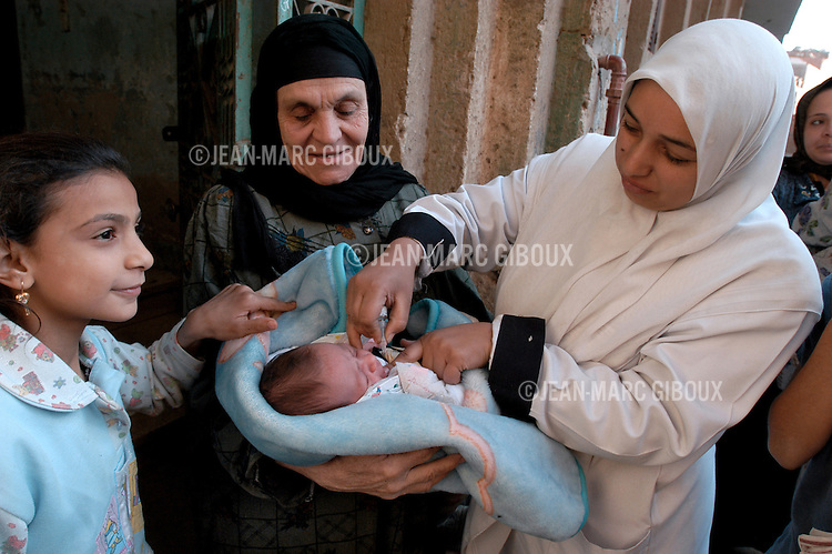 CAIRO, EGYPT- DECEMBER 4, 2004 : A health worker immunize a baby against polio during the national door to door polio vaccination campaign in Giza district near Cairo, on December 4, 2005. Egypt remains one of the 6 polio endemic countries in the world, with one case in 2004. (Photo by Jean-Marc Giboux/Getty Images)