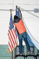 A man takes down banners after Vermont senator and Democratic presidential candidate Bernie Sanders speaks to senior citizens at the Peterborough Community Center gymnasium in Peterborough, New Hampshire.