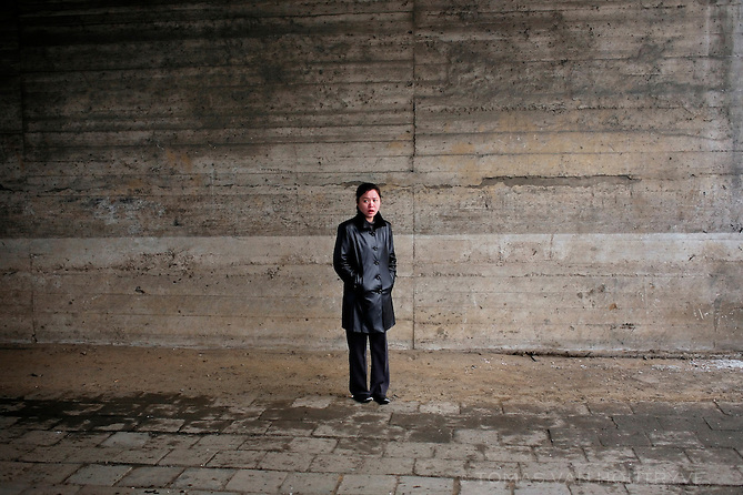 A woman waits under a bridge overpass in Pyongyang, North Korea (DPRK) on 25 February 2008.