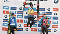March 14th 2020, Kontiolahti, Finland;  Second-placed Quentin Fillon Maillet, winner Martin Fourcade and third-placed Emilien Jacquelin, all of France, celebrate on the podium after the mens 12.5 km Pursuit competition at the IBU Biathlon World Cup in Kontiolahti, Finland, on March 14, 2020. Fourcade ends his career now at the end of the season in Kontiolahti where he took his first World Cup victory exactly 10 years ago on March 14, 2010.