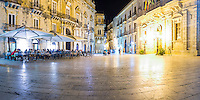 Panoramic photo of tourists eating at a restaurant in Piazza Duomo at night, Ortigia, Syracuse (Siracusa), UNESCO World Heritage Site, Sicily, Italy, Europe. This is a panoramic photo of tourists eating at a restaurant in Piazza Duomo at night, Ortigia, Syracuse (Siracusa), UNESCO World Heritage Site, Sicily, Italy, Europe.