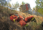 SPAIN, Vegas de Coria : An injured member of the Spanish Army Emergency Unit (UME) Mina lies on the ground following a car accident after battling a raging wildfire in Vegas de Coria, near Caceres, on July 28, 2009. on July 28, 2009. (C) Pedro ARMESTRE