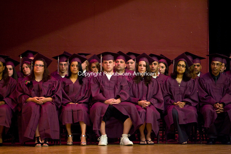 NAUGATUCK, CT - 20 MAY 2010 -052010JT12-<br /> Naugatuck Adult Education graduates sit on stage during Thursday's commencement exercises at Naugatuck High School. <br /> Josalee Thrift Republican-American