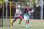 Orange, CA 05/01/10 - Connor Martin (Chapman # 99) and Thomas Holman (LMU # 3) in action during the LMU-Chapman MCLA SLC semi-final game in Wilson Field at Chapman University.  Chapman advanced to the final by defeating LMU 19-10.