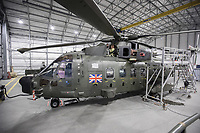 British Merlin helicopter in a heated hangar in the Arctic. Joint Helicopter Command trains in Bardufoss Norway every year.  <br /> <br /> 845 Naval Air Squadron is a squadron of the Royal Navy's Fleet Air Arm. Part of the Commando Helicopter Force, it is a specialist amphibious unit operating the Leonardo Commando Merlin Mk3 helicopter and provides troop transport and load lifting support to 3 Commando Brigade Royal Marines.<br /> <br /> ©Fredrik Naumann/Felix Features
