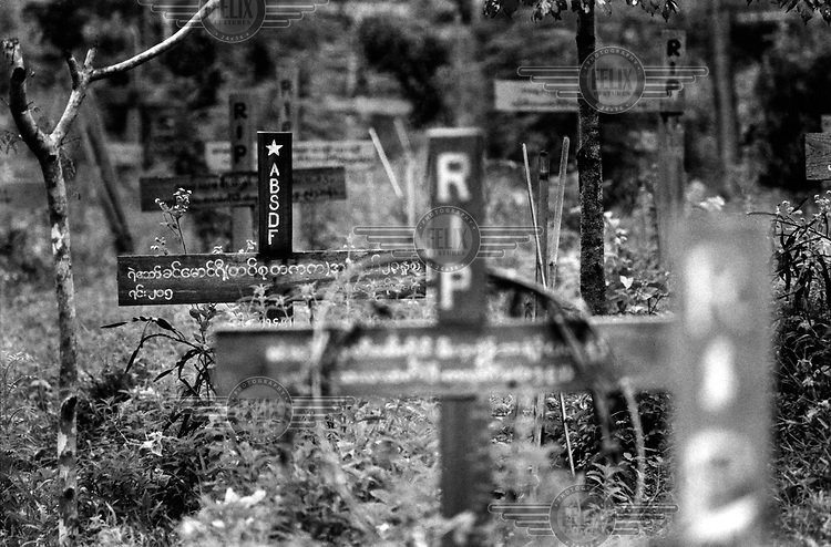 The graveyard at the former headquarters of the Karen National Union in Manerplaw. Among the crosses is a grave belonging to a member of the All Burma Students Democratic Front (ABSDF), which was set up on the border in 1989 by students who fled the bloody crackdown by the military regime in 1988.