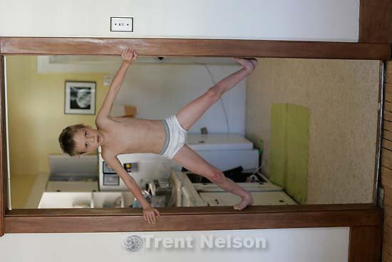 Nathaniel Nelson wall-climbing.<br />