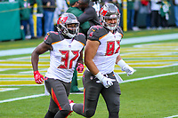 Tampa Bay Buccaneers safety Keith Tandy (37) and tight end Antony Auclair (82) during a National Football League game against the Green Bay Packers on December 2nd, 2017 at Lambeau Field in Green Bay, Wisconsin. Green Bay defeated Tampa Bay 26-20. (Brad Krause/Krause Sports Photography)