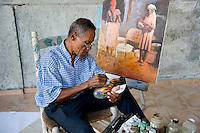 After the January 12, 1010 earthquake. Franck Loussaint, artist, painting in his studio. Since the earthquake he paints this theme, as well as painting restorations.