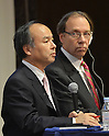 October 15, 2012, Tokyo, Japan - President Masayoshi Son, left, of Japan's  Softbank and Dan Hesse, CEO of Sprint Nextel Corp. of U.S., attend a presentation in Tokyo, where they announced a deal between the two mibile phone companies on Monday, October 15, 2012...Sharp Corp. announced that it is.Softbank and Sprint, the third-largest mobile phone companies in Japan and U.S.respectively, have reached the agreement under which the Japanse mobile company pays $20 billion to acquire a 70% stake in the U.S. cellular phone company, thus creating one of the the leading communications groups in the world with a total of 90 million mobile phone subscriptions.  (Photo by Natsuki Sakai/AFLO) AYF -mis-