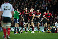 20121216 Copyright onEdition 2012©.Free for editorial use image, please credit: onEdition.Saracens players celebrate winning during the Heineken Cup Round 4 match between Saracens and Munster Rugby at Vicarage Road on Sunday 16th December 2012 (Photo by Rob Munro)..For press contacts contact: Sam Feasey at brandRapport on M: +44 (0)7717 757114 E: SFeasey@brand-rapport.com..If you require a higher resolution image or you have any other onEdition photographic enquiries, please contact onEdition on 0845 900 2 900 or email info@onEdition.com.This image is copyright onEdition 2012©..This image has been supplied by onEdition and must be credited onEdition. The author is asserting his full Moral rights in relation to the publication of this image. Rights for onward transmission of any image or file is not granted or implied. Changing or deleting Copyright information is illegal as specified in the Copyright, Design and Patents Act 1988. If you are in any way unsure of your right to publish this image please contact onEdition on 0845 900 2 900 or email info@onEdition.com